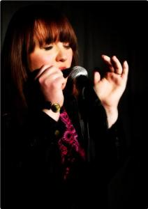 Katie-playing-the-blues-harp